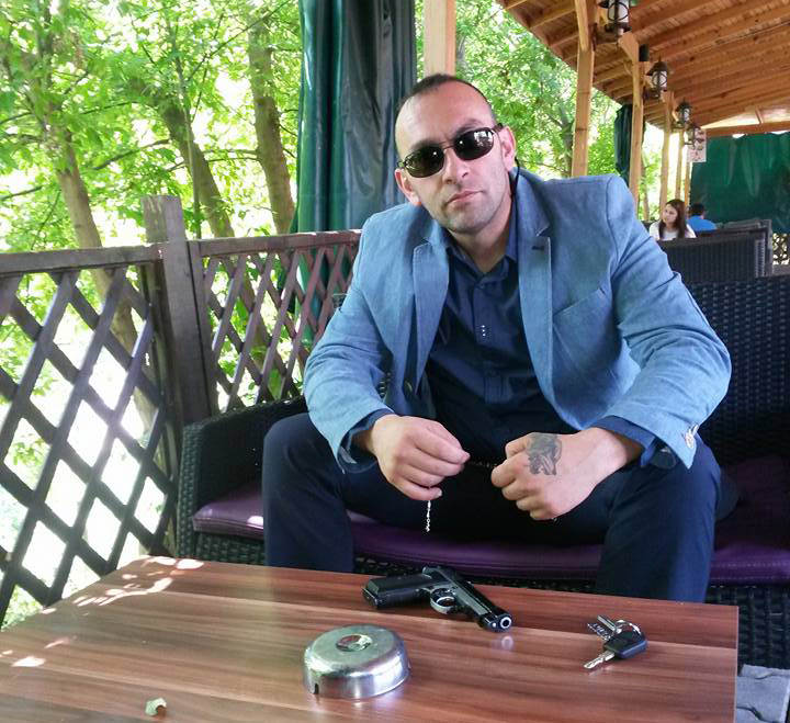 Başoral posted an image of himself on Facebook posing with gun on July 1, 2015