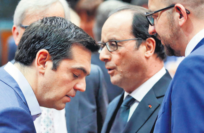 Greek PM Tsipras (L) listens to French President Hollande (C) next to Belgian PM Michel (R) during a eurozone leaders summit in Brussels, Belgium on July 12.