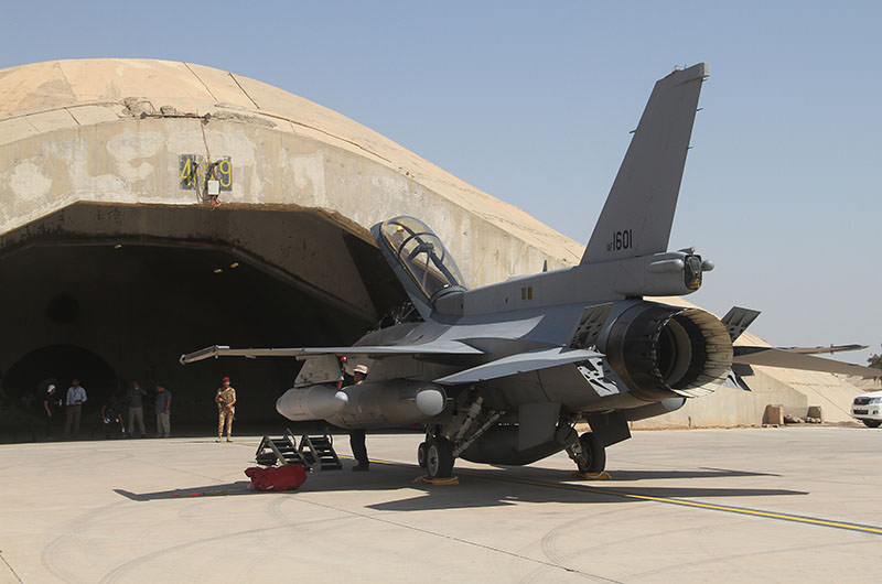 One of four new U.S.- made F-16 fighter jets sits outside a hangar upon their arrival to Balad air base, 75 kilometers (45 miles) north of Baghdad, Iraq, Monday, July 13, 2015 (AP Photo)