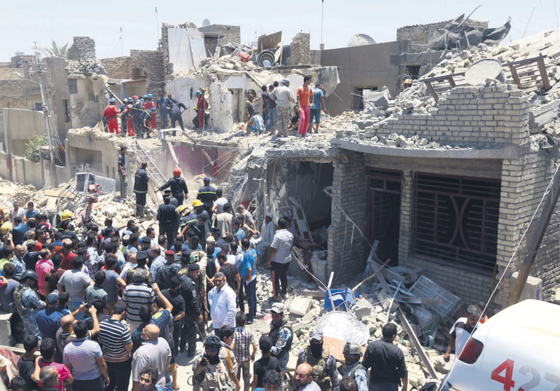 Iraqi security forces search for survivors after a bombing in the eastern neighborhood of New Baghdad, Iraq