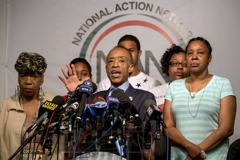 Rev. Al Sharpton speaks with the family of Eric Garner during a news conference in New York July 14, 2015 (Reuters Photo)