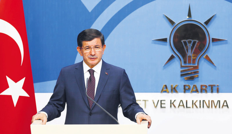 Turkey's Prime Minister Ahmet Davutou011flu speaks during a news conference at AK Party headquarters in Ankara after his visit of main opposition party CHP.