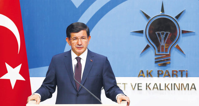 Turkey's Prime Minister Ahmet Davutoğlu speaks during a news conference at AK Party headquarters in Ankara after his visit of main opposition party CHP.