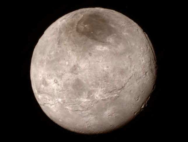Pluto's primary moon, Charon, which was believed to be geologically dead. Instead, New Horizons found troughs, cliffs and giant canyons
