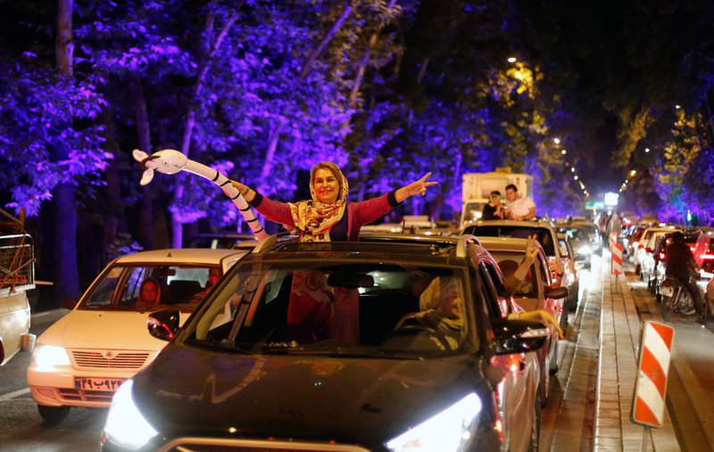 Iranians celebrate in the streets of Tehran, Iran, after nuclear talks between Iran and the six powers ended in Vienna.