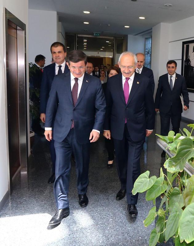 PM Davutou011flu (L) meets main opposition CHP chairman Ku0131lu0131u00e7darou011flu as part of the first round of coalition talks in Ankara on Monday.