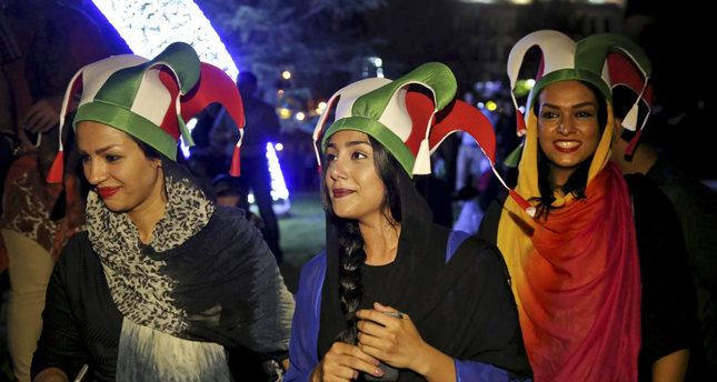 Iranian women take part in street celebrations in Tehran following a landmark nuclear deal, which is expected to increase commercial ties with Turkey.