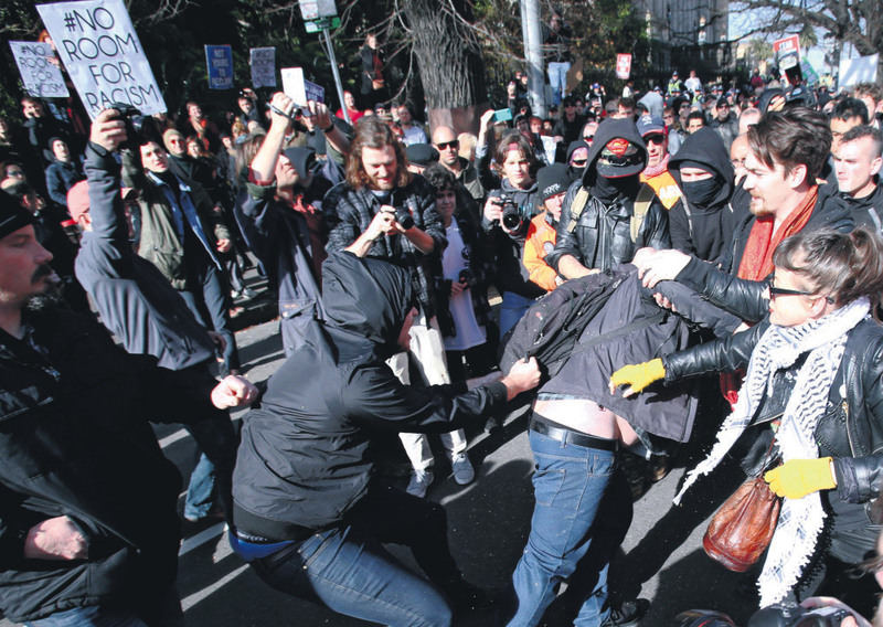 Protesters clash during a protest between far-right group United Patriots and anti-racism protesters in Melbourne, Australia.