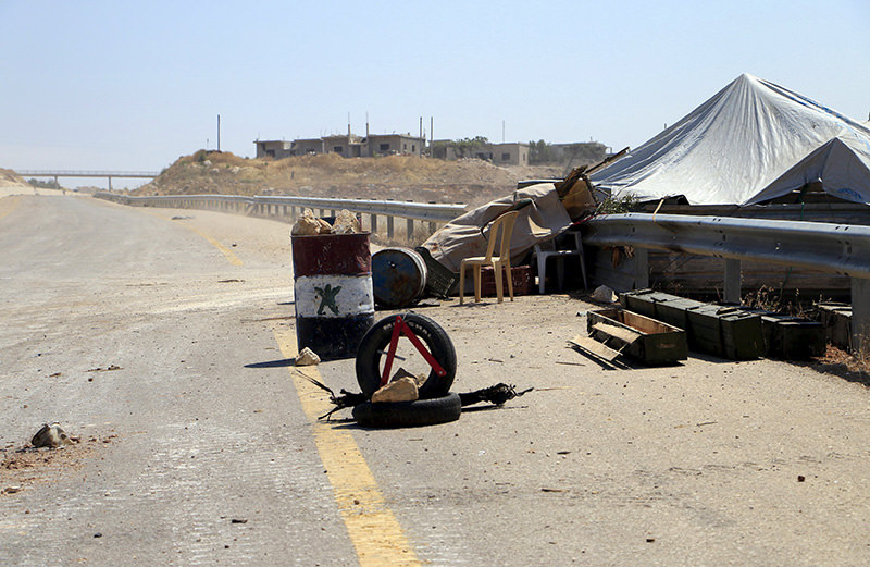 A checkpoint that belonged to Assadu2019s forces is seen after a coalition of rebel groups called Jaish al Fateh said they took control of it, on a highway that connects Aleppo to Latakia, June 6, 2015 (Reuters)