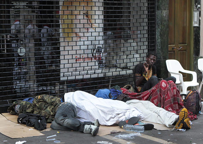 African migrants from Senegal sleeping rough on the streets of Pamplona, northern Spain, 12 July 2015 (EPA Photo)