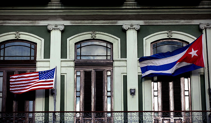 Cuban and American flag wave from the balcony of the Hotel Saratoga in Havana (AP Photo)