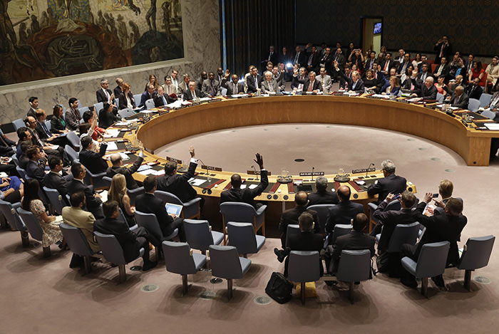 Members of the Security Council vote at United Nations headquarters, Monday, July 20, 2015 (AP Photo)