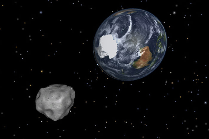 Photo shows simulation of asteroid 2012 DA14 approaching from the south as it passes through the Earth-moon system on Friday, Feb. 15, 2013