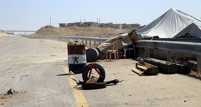A checkpoint that belonged to Assad's forces is seen after a coalition of rebel groups called Jaish al Fateh said they took control of it, on a highway that connects Aleppo to Latakia, June 6, 2015 (Reuters)