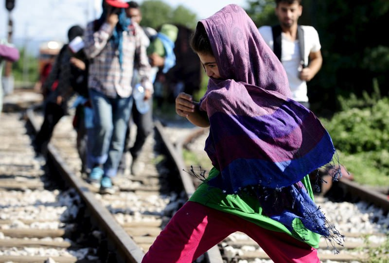 A migrant child runs at Gevgelija train station in Macedonia near the border with Greece.
