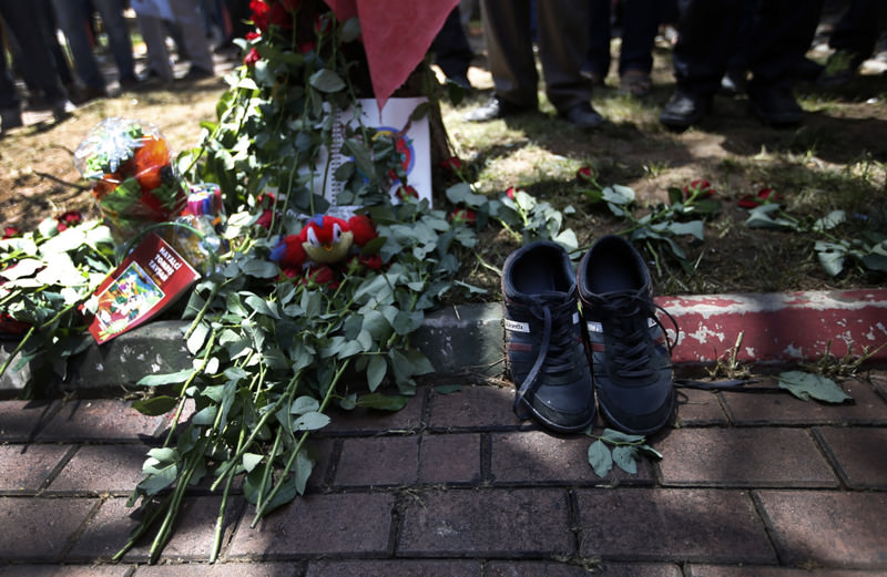 A pair of shoes belonging to a victim are seen next to flowers, laid down by mourners at the site of Monday's explosion in the Suruu00e7 district of u015eanlu0131urfa province in Turkey, near the Syrian border.