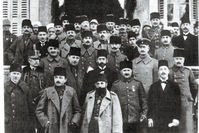 Enver and Cemal Pasha, the leaders of the Commitee of Union and Progress, which seized power after Sultan Abdülhamid II was dethroned, stand in front of other commitee members. Along with Talat Pasha, they were known as the 'Three Pashas.'