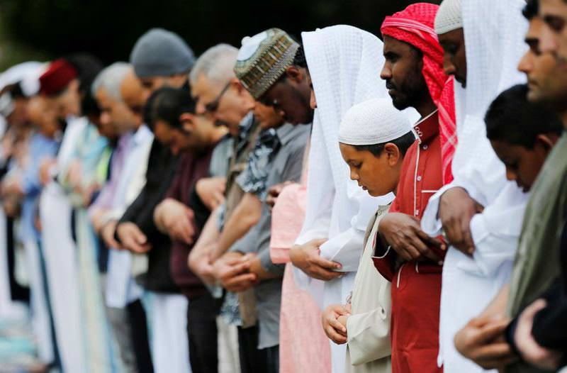 Muslims perform prayers for Eid-al Fitr to mark the end of the holy fasting month of Ramadan at a park in London, Britain.