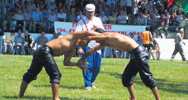 Turkish wrestlers compete in historical oil wrestling competition