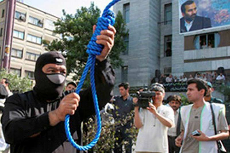 A hangman is preparing  noose for a public execute in Iranian capital, Tehran.