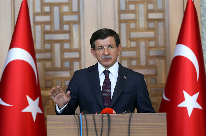 Turkish Prime Minister Ahmet Davutoglu speaks to the media in Ankara, Turkey, Friday, July 24, 2015 (AP Photo)