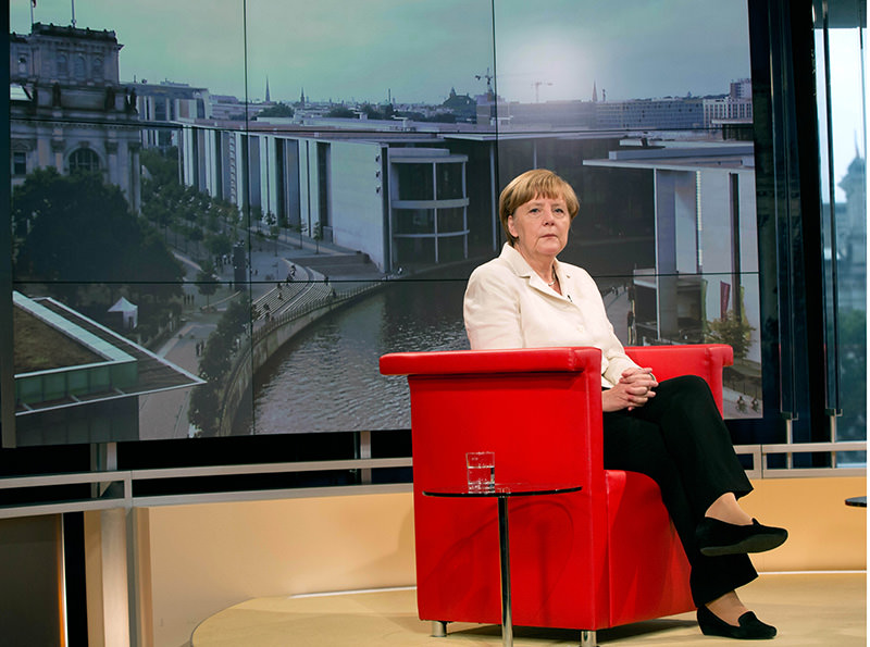 German Chancellor Angela Merkel waits prior to an interview at the TV studios of German public broadcaster ARD in Berlin, Germany, Sunday, July 19, 2015 (AP photo)