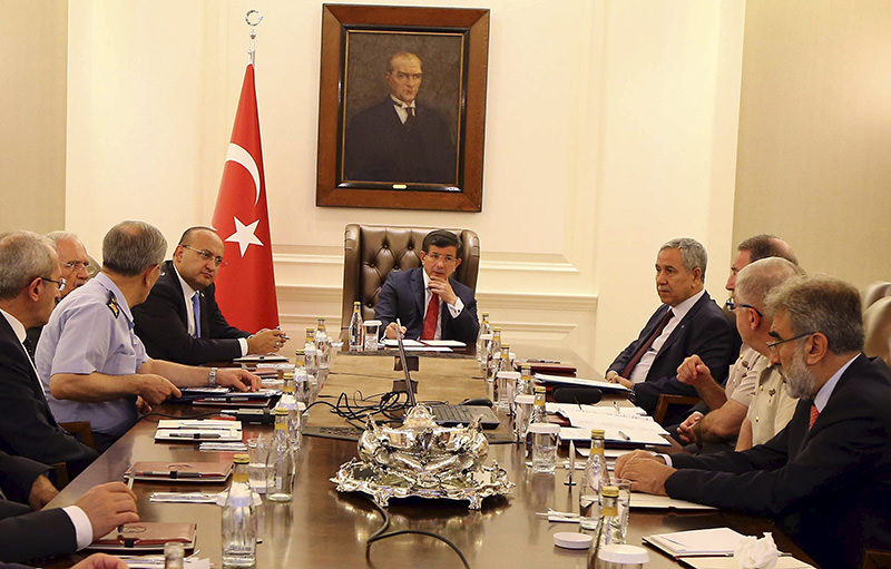 Turkey's Prime Minister Ahmet Davutou011flu (C) chairs a security meeting in Ankara, Turkey, in this July 25, 2015 handout provided by Turkey's Prime Minister's Press Office (Reuters photo)