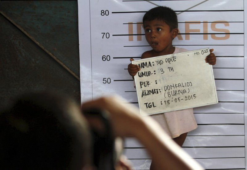 A Rohingya child who recently arrived by boat has his picture taken for identification purposes at a shelter in Kuala Langsa in Indonesia's Aceh Province.