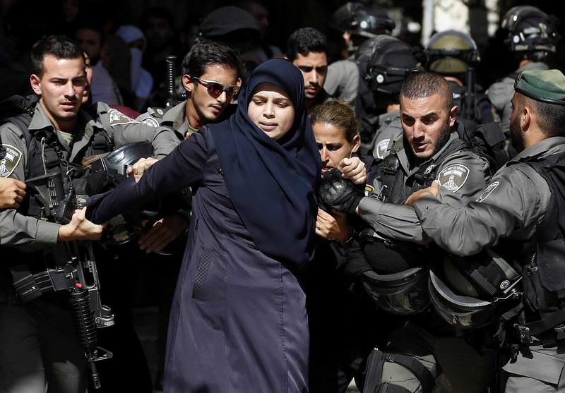 After the raid on Al-Aqsa compound, Israeli soldiers arrested many, including women.