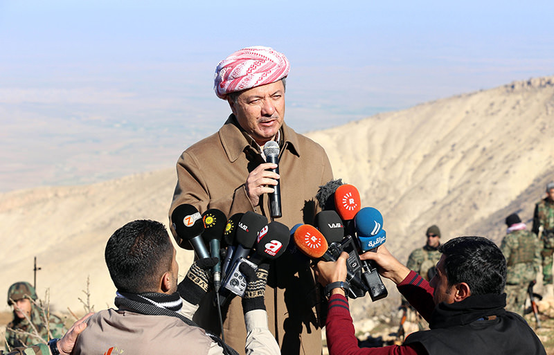 Iraqi Kurdish leader Masoud Barzani speaks to journalists on December 21, 2014 during a visit to Mount Sinjar in the autonomous Kurdistan region, in northwestern Iraq (AFP photo)