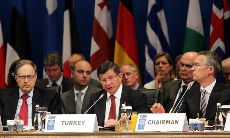Prime Minister Ahmet Davutou011flu (C) and NATO Secretary-General Jens Stoltenberg of Norway (R) at NATO's Foreign Ministers' Meeting held in Turkey's Antalya province in May.