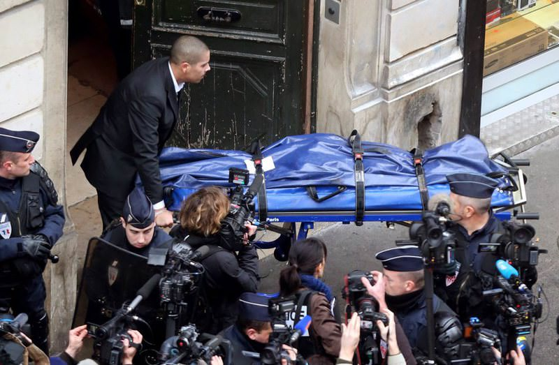 The body of one of the victims in the 2013 attack that killed three women being carried from the offices of the Kurdish Information Bureau in Paris.