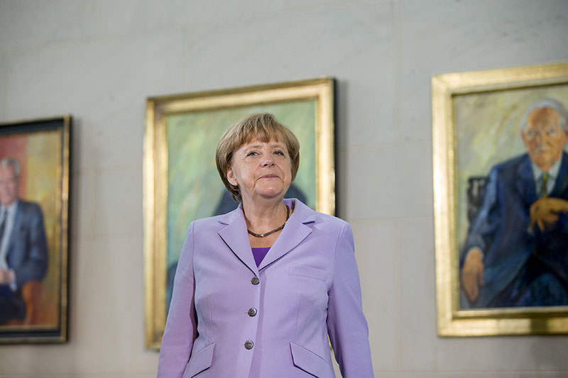 German Chancellor Angela Merkel receives diplomatic corps in the Chancellery in Berlin, July 13, 2015. Merkel stands in front of portraits of former German chancellors (Reuters photo)