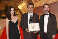 Nuri Bilge Ceylan (C) attended the 67th Cannes Film Festival with actress Melisa Sözen (L) and actor Ayberk Pekcan (R), who starred in his Palme d'Or winning film Winter Sleep.