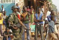 Soldiers from the Democratic Republic of Congo, part of an African peacekeeping force in CAR, patrol a street in Bangui on Feb. 12, 2014.