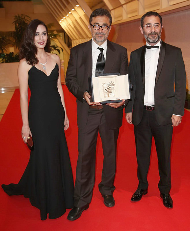 Nuri Bilge Ceylan (C) attended the 67th Cannes Film Festival with actress Melisa Su00f6zen (L) and actor Ayberk Pekcan (R), who starred in his Palme d'Or winning film ,Winter Sleep.,