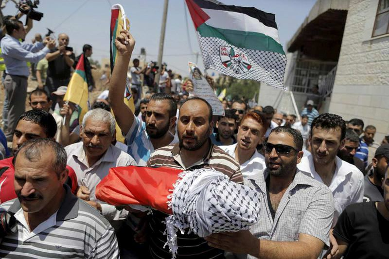 Palestinian mourners carry the body of 18-month-old Ali Dawabsheh who was killed by extremist Jewish settlers.