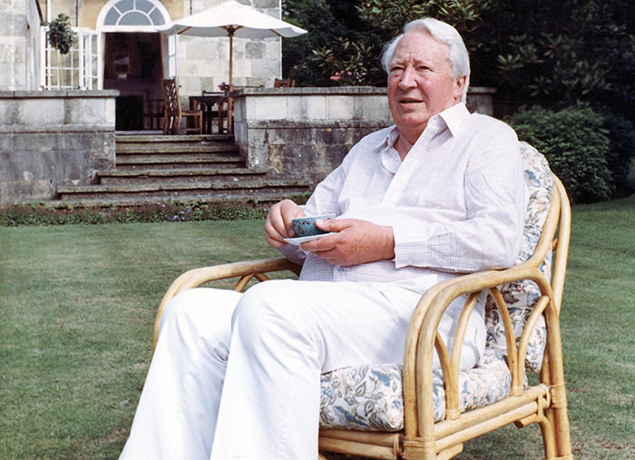 1989 file photo of former British Prime Minister Edward Heath as he takes tea in the garden of his home in Salisbury, England (AP Photo)