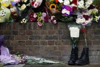 A pair of army boost with bouquets for Lee Rugby, who was killed by two Muslim converts of Nigerian descent in retribution for Muslim deaths. The attackers were allegedly contacted by MI6.