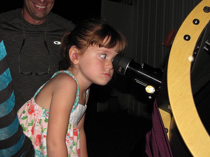 Elizabeth u201cLizzyu201d Myers, 5, gazes through a telescope at the Warren Rupp Observatory in Bellville, Ohio (AP Photo)