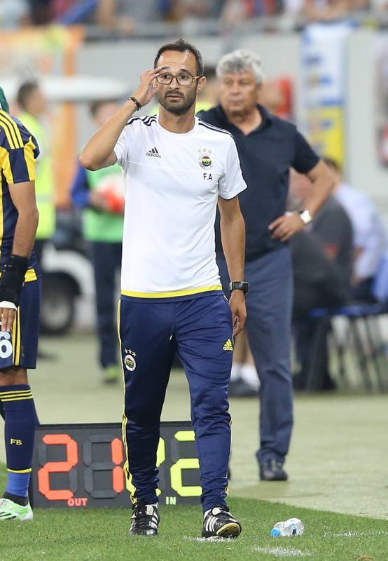 Shakhtar Donetsk's coach Lucescu (back) said rival coach Vitor Pereira's sending off was risky but it was the right decision.