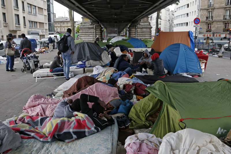 Migrants, many from Eritrea, at a makeshift camp under a metro bridge in Paris.