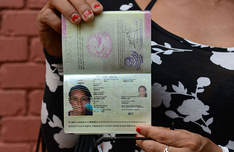 Nepalese transgender and the first recipient of a Nepalese transgender passport, Monica Shahi from Kailali district displays her new passport with ,O, for other in the document's gender section, in Kathmandu on August 10, 2015 (AFP photo)
