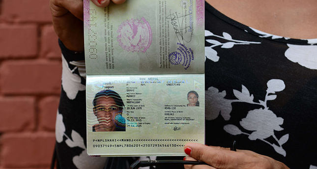 Nepalese transgender and the first recipient of a Nepalese transgender passport, Monica Shahi from Kailali district displays her new passport with O for other in the document's gender section, in Kathmandu on August 10, 2015 (AFP photo)