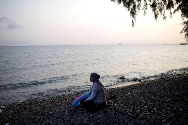 A Syrian migrant woman sitting on a beach on the Greek island of Kos, after fleeing from her country in fear of the escalating violence by ISIS and the Assad regime.