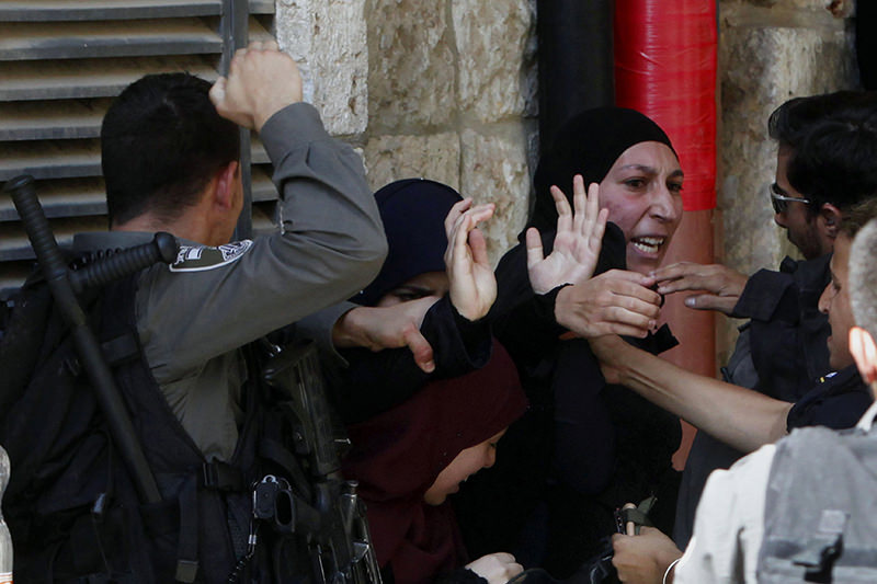 Israeli border police officers scuffle with Palestinian women during clashes in the Old City of Jerusalem on Sunday, July 26, 2015 (AP Photo)