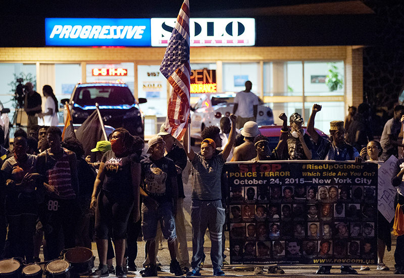 Protesters line West Florissant Avenue to mark the one-year anniversary of the death of Ferguson teenager Michael Brown Jr. in Ferguson (EPA Photo)