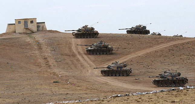 Turkish army tanks take up position on the Turkish-Syrian border near the southeastern town of Suruc in Sanliurfa province September 29, 2014 Reuters Photo
