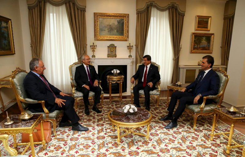 Republican People's Party (CHP) Chairman Kemal Ku0131lu0131u00e7darou011flu (2nd L) meets with Prime Minister Ahmet Davutou011flu (2nd R) as part of their coalition talks in Ankara.