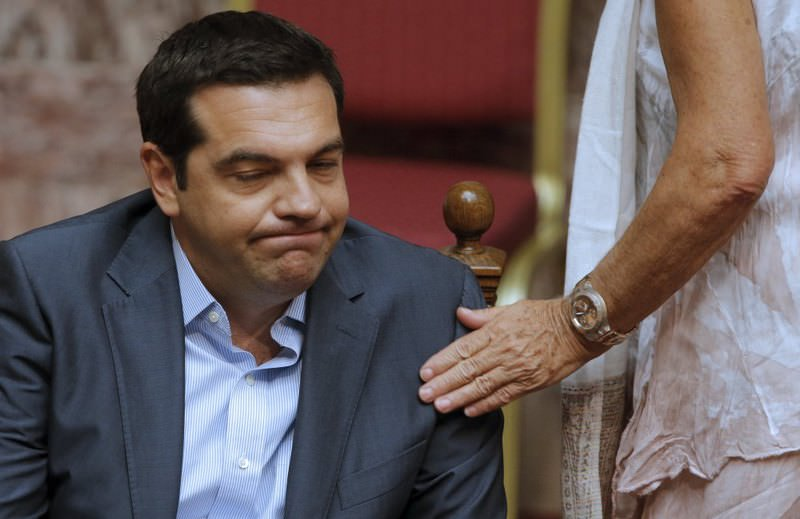 Greek Prime Minister Alexis Tsipras reacts as he attends a parliamentary session yesterday in Athens, Greece.